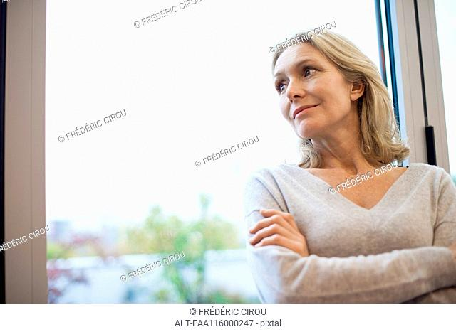 Businesswoman standing near window