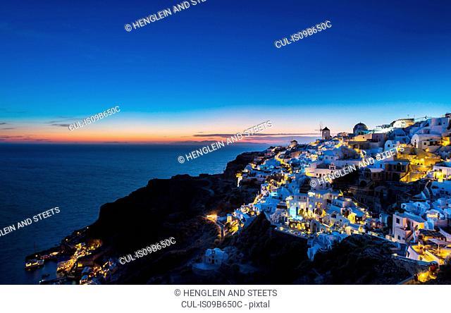 Cliff houses illuminated at night, Athens, Attiki, Greece, Europe