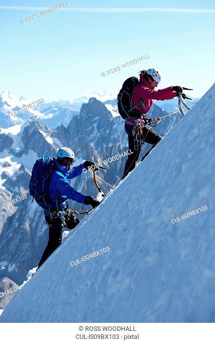 Mountain climber on snowy slope, Chamonix, Rhone-Alps, France