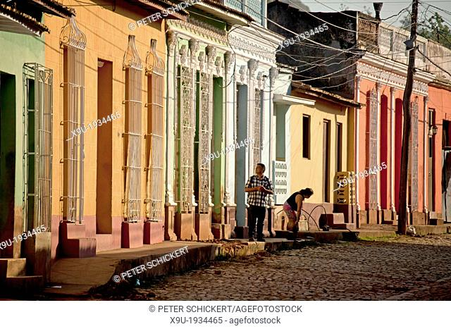 typical cobblestone street with colourful homes in the old town of Trinidad, Cuba, Caribbean