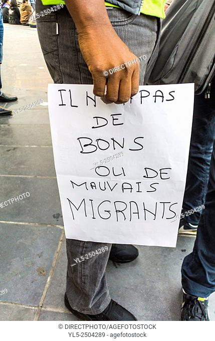 "Paris, France, French Demonstration to Expand Rights of Asylum Seekers, Migrants, to enter France, Detail, Hand Holding Protest Sign """"There are no Good or Bad..."