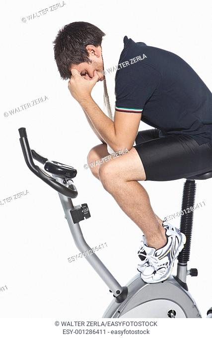 man who pedal stationary bikes, cyclette