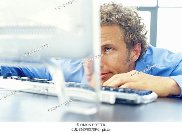 Bored businessman resting on desk