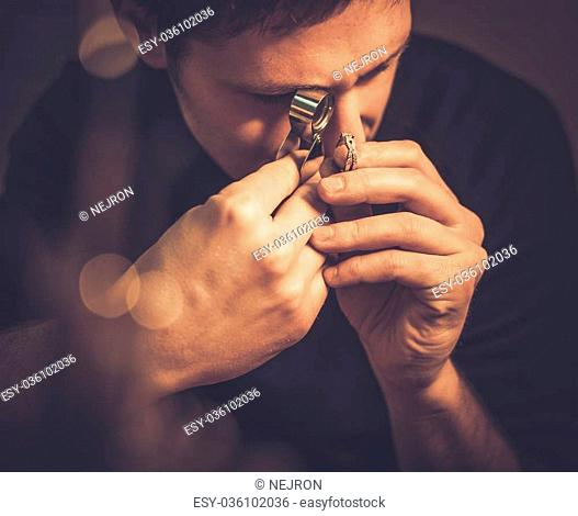 Portrait of a jeweler during the evaluation of jewels
