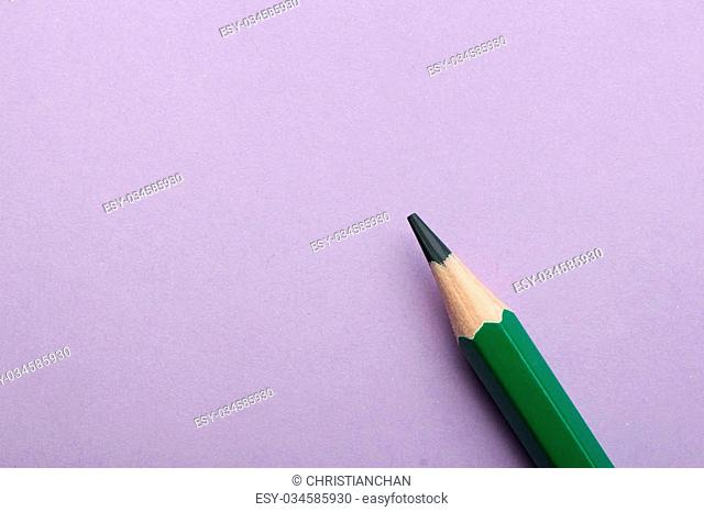 Color pencil is lying on the colored background with copy space