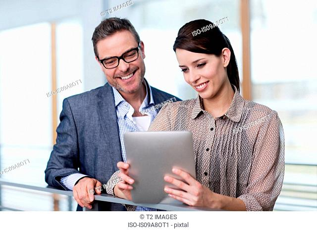 Man and woman looking at digital tablet