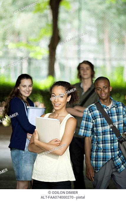 University students, focus on woman in foreground