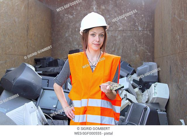 Portrait of female technician at recycling yard of aluminium