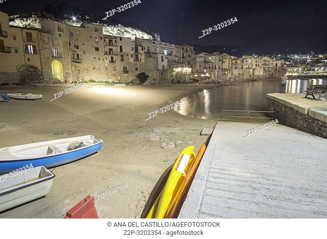 Cefalu seascape by night Sicily village on the sea Italy