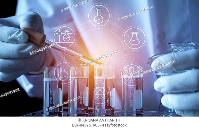 Researcher with glass laboratory chemical test tubes with liquid for analytical , medical, pharmaceutical and scientific research concept