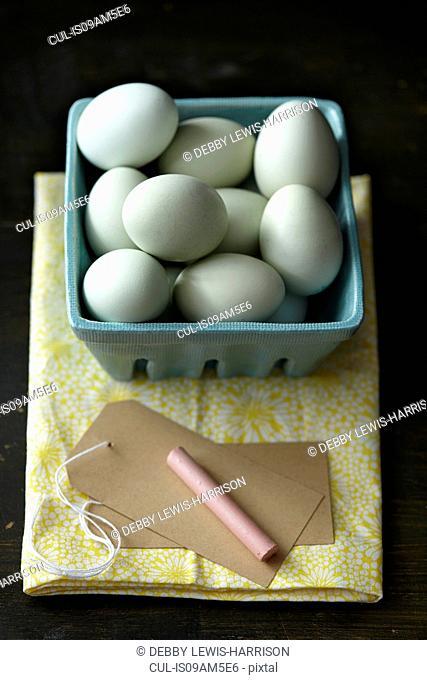 Chicken eggs, chalk, tag, kitchen towel