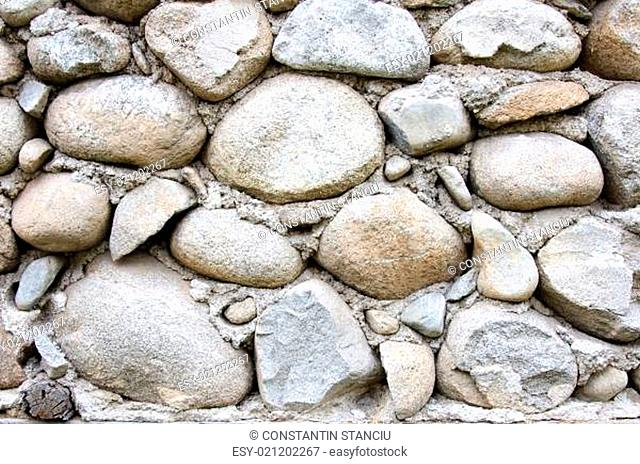 Detail of round stones and cement wall