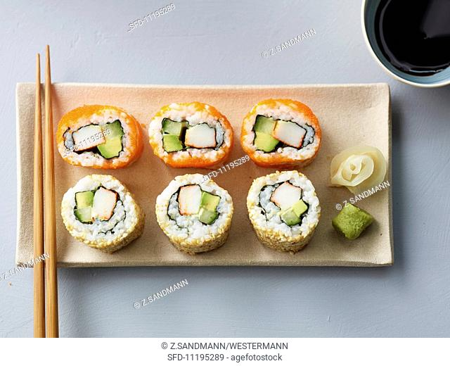 Six California rolls with soy sauce, ginger and wasabi