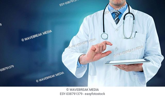 Male doctor holding tablet