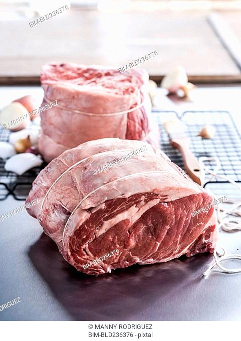 Raw beef rib roast wrapped with string