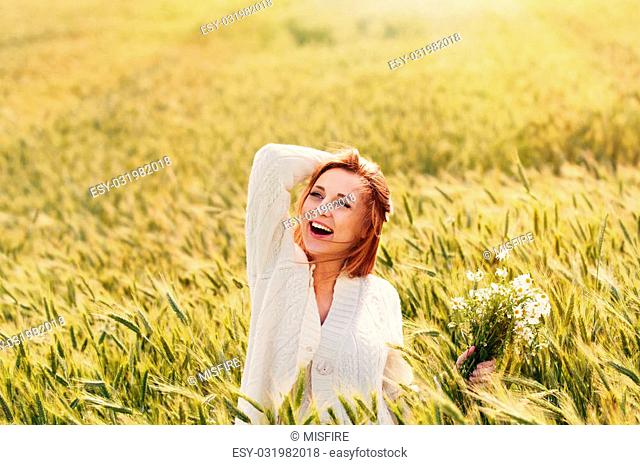 young happy smiling woman enjoy harmony of nature outdoor in sunny summer day
