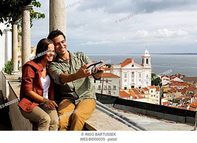 Portugal, Lisboa, Alfama, Miradouro de Santa Luzia, young couple photographing themself