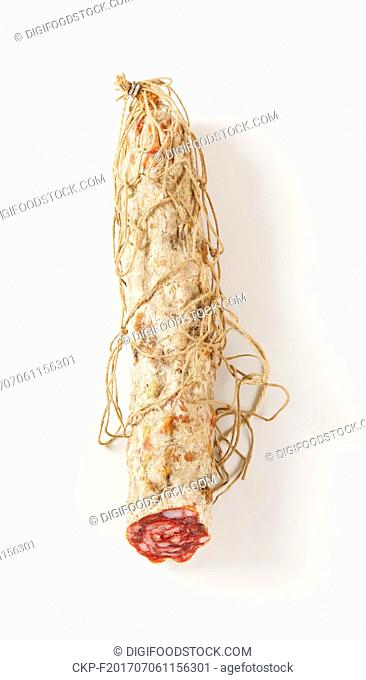 Dry cured pork sausage on white background