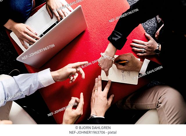 Peoples hands during meeting