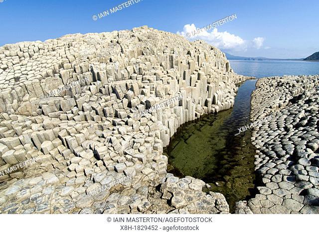 Columnar basalt volcanic rock formations at Stolbchaty Cape on Kunashir Island in Kuril Islands Far East Russia