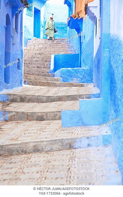 Woman down the stairs in Chaouen