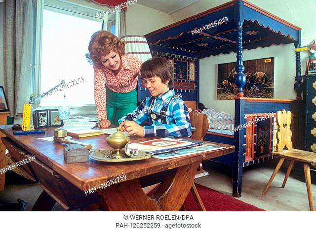 In the 1970s, Liselotte Pulver helpes her son Marc-Tell with his homework in her house near Lausanne. Swiss actress Lilo Pulver was born on 11 October 1929 in...
