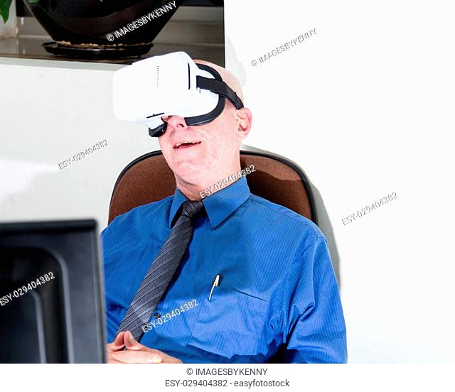Amazed corporate executive wearing virtual reality headset