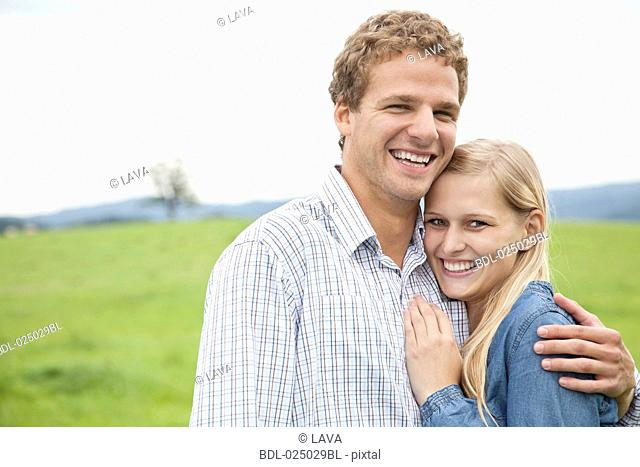 portrait of young couple on meadow