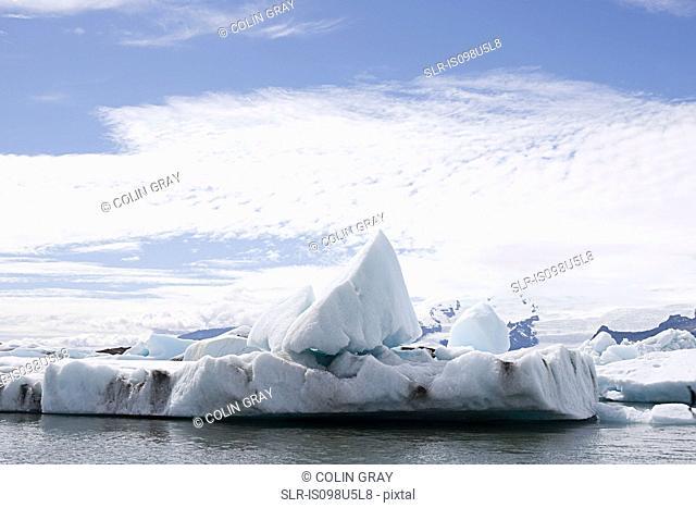 Iceland, iceberg in jokulsarlon lagoon drifting from vatnajokull glacier into the north atlantic ocean