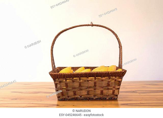 mango in basket on table vintage