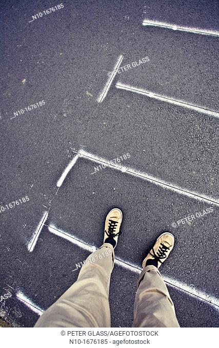 Close-up of a man standing in a crosswalk