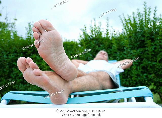 Man relaxing in a deck chair