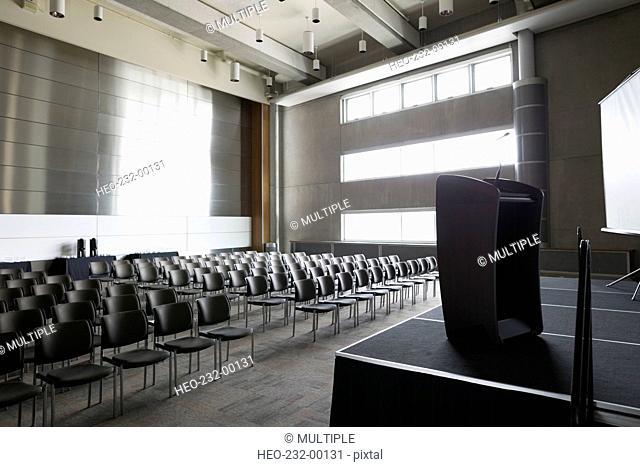 Podium on stage in empty auditorium