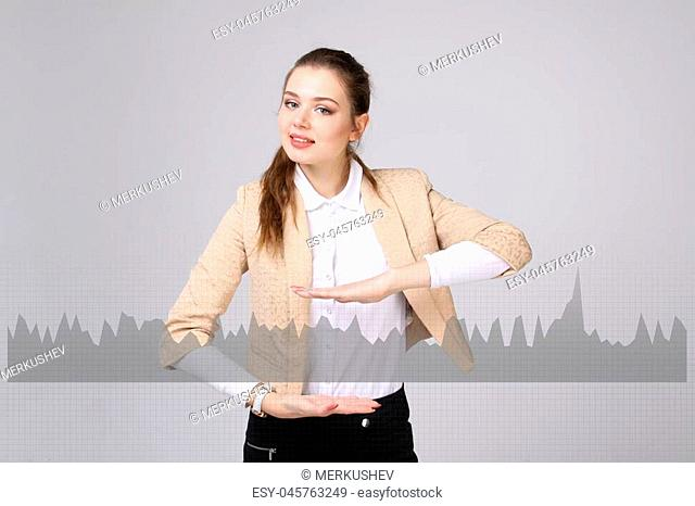 Young businesswoman working with graph chart. Future technologies for busines, stock market concept