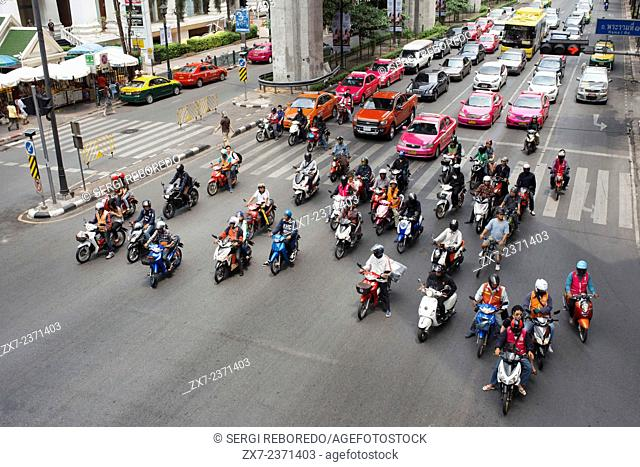 Traffic in Bangkok Near MBK Centre Thailand South East Asia. Motorbikes are ubiquitous in Thailand, but helmets are not. Activists aim to tackle a problem that...