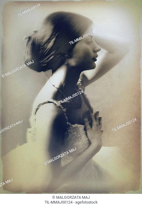 A sepia-toned portrait of a womans profile, seated, with her left hand touching her hair