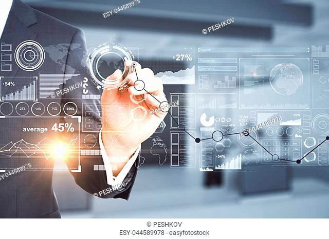Businessman drawing abstract business chart hologram on blurry office interior background. Futuristic concept. Double exposure