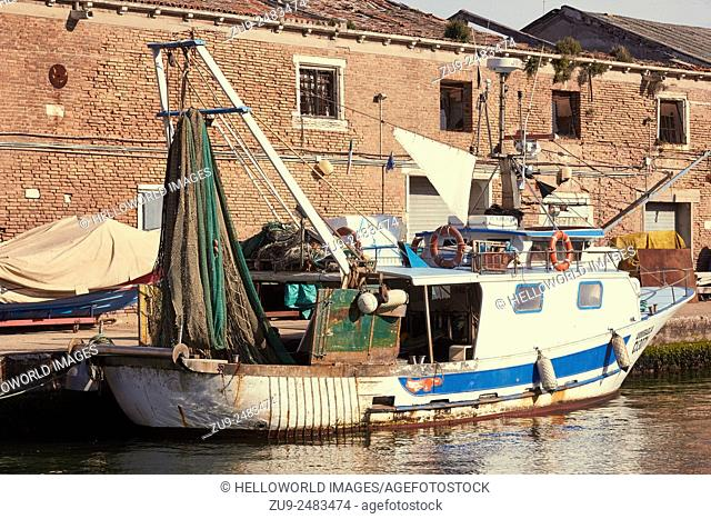 Fishing Trawler with nets hanging up, moored on a canal, Chioggia, Venetian Lagoon, Veneto, Italy, Europe