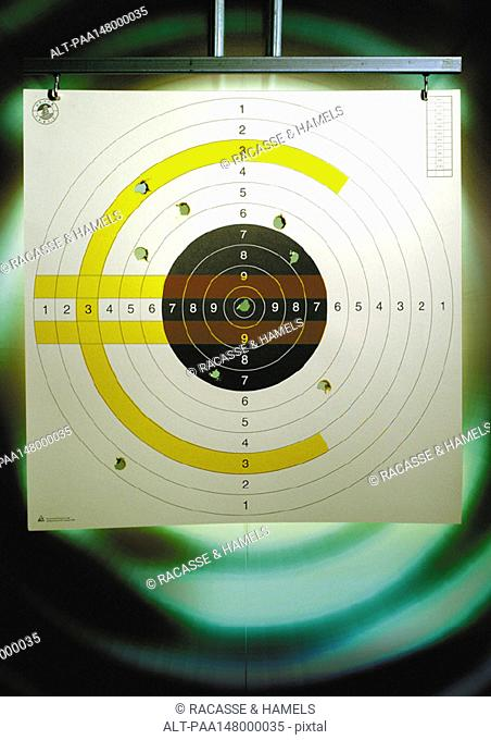 Euro sign on a paper shooting target