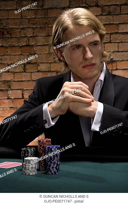Man playing cards in casino