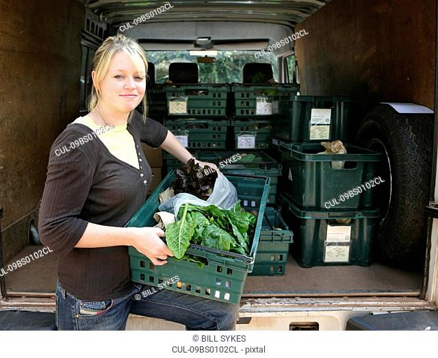 farm worker loading van