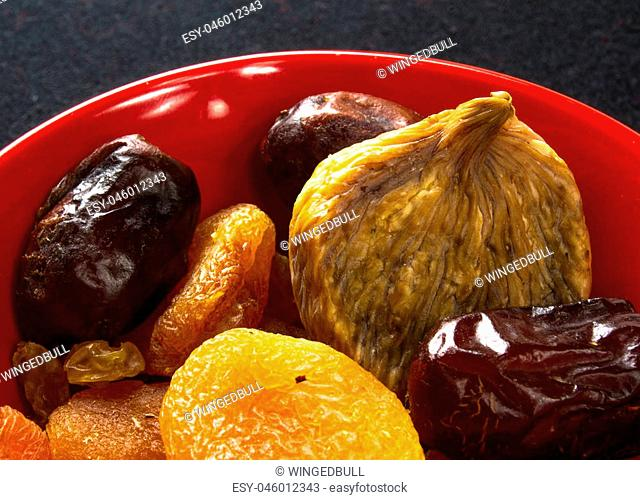 various dried fruits on the black background