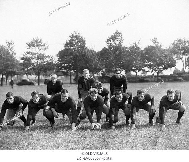 Football team in field All persons depicted are not longer living and no estate exists Supplier warranties that there will be no model release issues