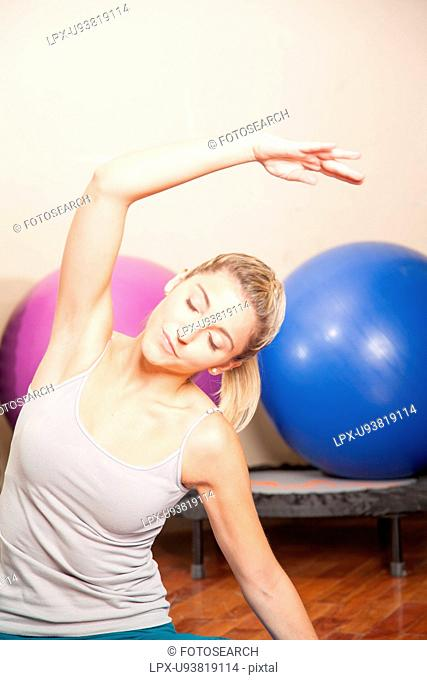 Woman stretching in yoga