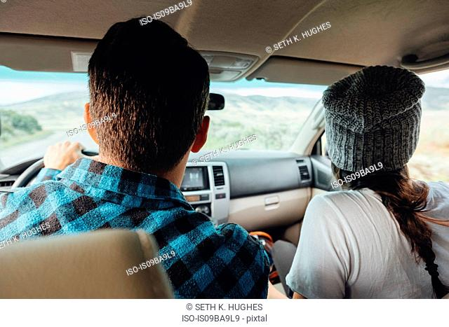 Couple in car, on road trip, rear view, Silverthorne, Colorado, USA