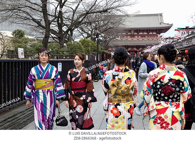 Girls with traditional dress in Senso-ji Temple in Tokyo, Japan. It is the most famous Buddhist temple in Asakusa district