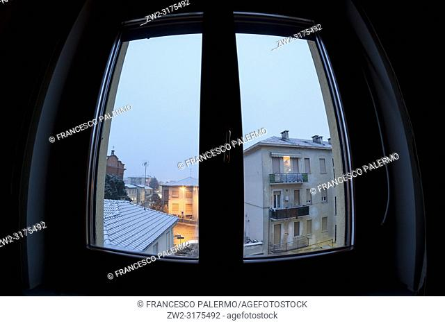 Looking out the window at the winter landscape. Domodossola, Piedmont. Italy
