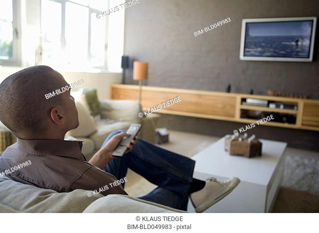 African American man watching television