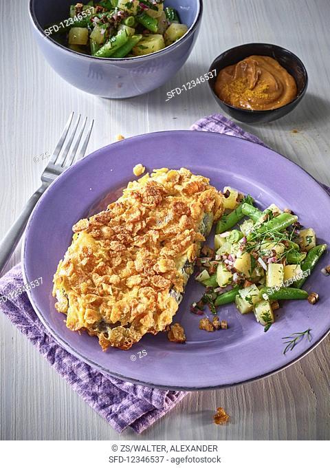 Crispy eggplant with potato salad and a curry dip