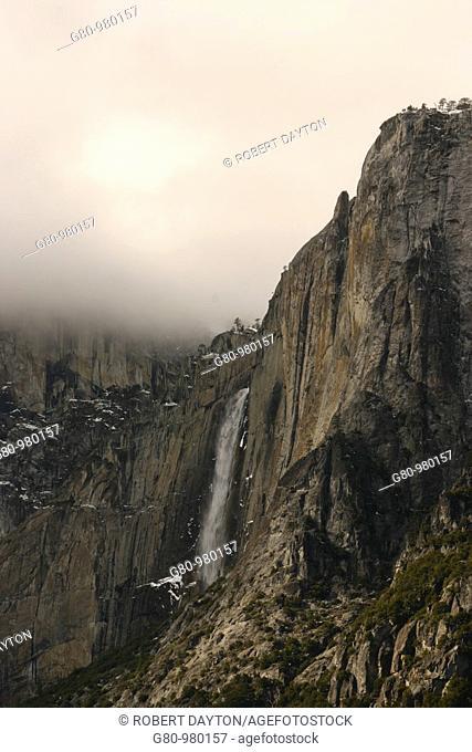 Yosemite Falls falls over the side of a granite monolith